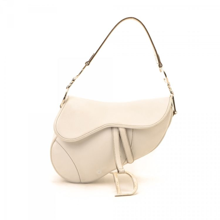 925b889e4cd LXRandCo guarantees the authenticity of this vintage Dior Saddle Bag  shoulder bag. This lovely shoulder bag in beautiful white is made of  leather.