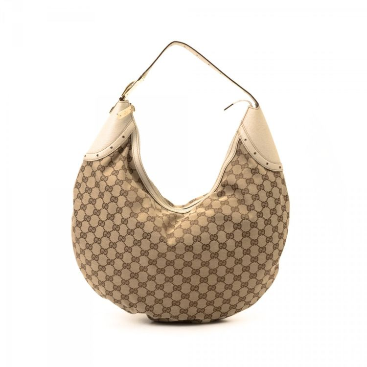 bd3361dbe2c The authenticity of this vintage Gucci Glam Hobo Bag shoulder bag is  guaranteed by LXRandCo. Crafted in gg canvas