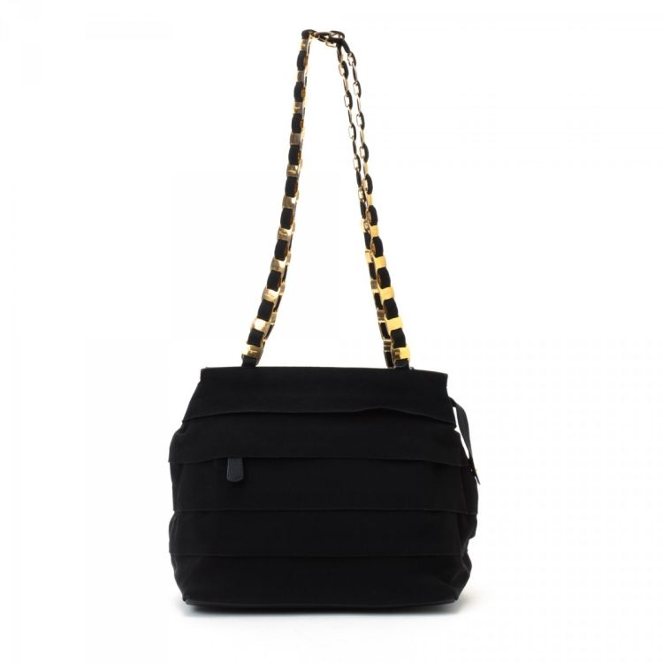 LXRandCo guarantees this is an authentic vintage Ferragamo Vara Chain  shoulder bag. Crafted in canvas, this stylish pocketbook comes in beautiful  black. Due ... f346c28e1a