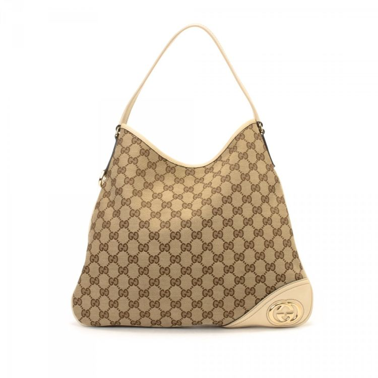9fa437b10e34 The authenticity of this vintage Gucci New Britt Hobo Bag shoulder bag is  guaranteed by LXRandCo. Crafted in gg canvas, this lovely bag comes in  beige.