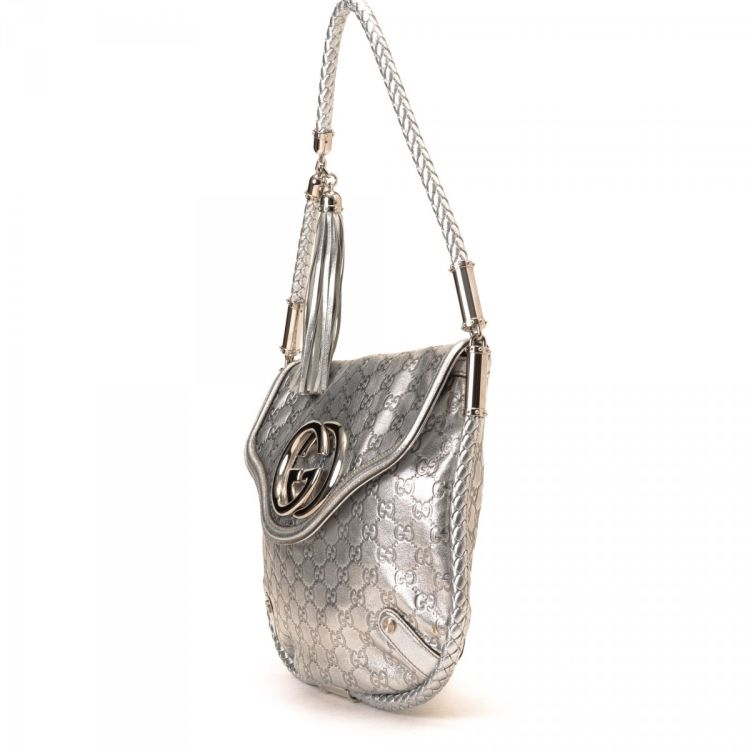 b9af5663b5da6c LXRandCo guarantees this is an authentic vintage Gucci Britt shoulder bag.  Crafted in guccissima leather, this iconic purse comes in beautiful silver  tone.