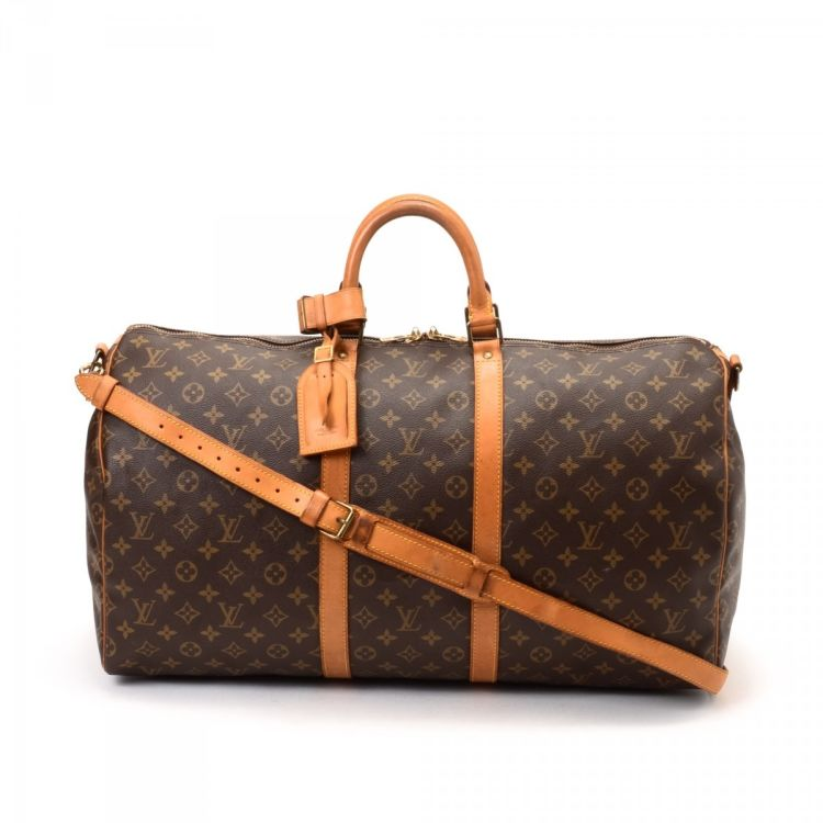 b48ededc4ad3 The authenticity of this vintage Louis Vuitton Keepall Bandouliere 55  travel bag is guaranteed by LXRandCo. Crafted in monogram coated canvas
