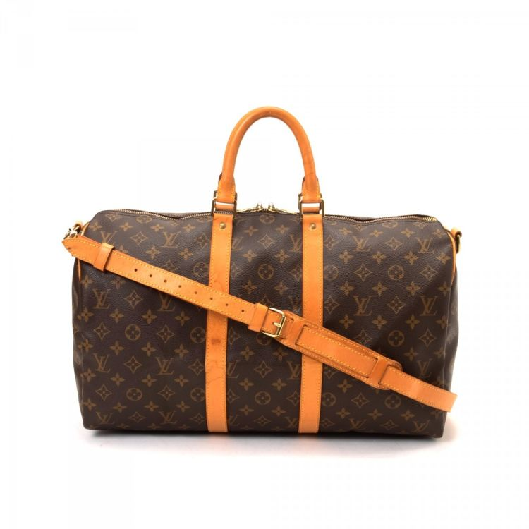 6454e04284ca LXRandCo guarantees the authenticity of this vintage Louis Vuitton Keepall  Bandouliere 45 travel bag. This stylish carryall was crafted in monogram  coated ...
