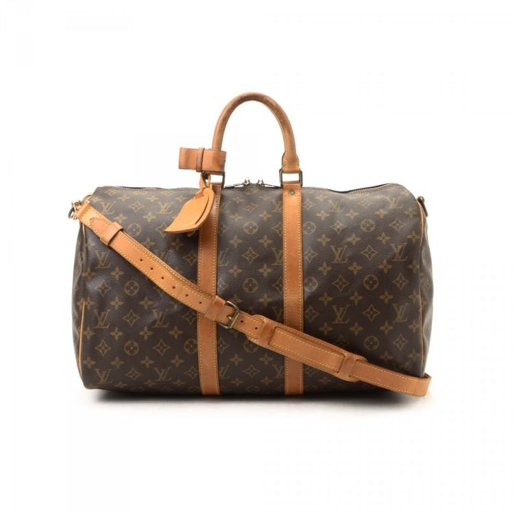 de6c2b12b081c ... of this vintage Louis Vuitton Keepall Bandouliere 45 travel bag. This  elegant duffel bag in beautiful brown is made in monogram coated canvas.