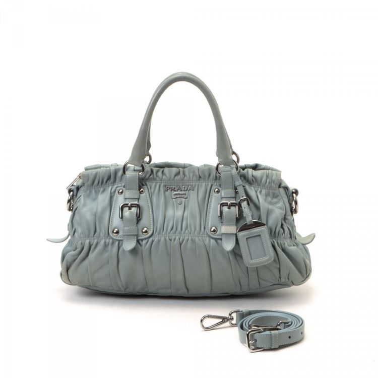 06ddb7815473 LXRandCo guarantees this is an authentic vintage Prada Nappa Gaufre Bag  handbag. Crafted in lambskin
