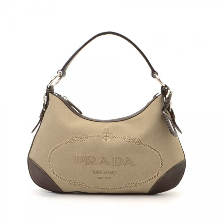 afbac6ad72c6 The authenticity of this vintage Prada Logo Jacquard shoulder bag is  guaranteed by LXRandCo. This everyday shoulder bag comes in beige canvas.