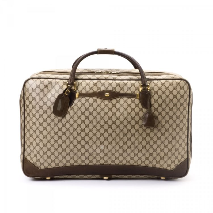 9b17f81a2292 LXRandCo guarantees this is an authentic vintage Gucci Soft Sided Suitcase  travel bag. This lovely travel bag was crafted in gg coated canvas in beige.
