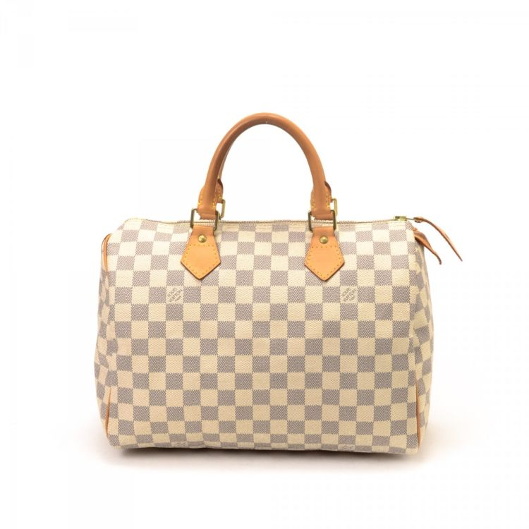 20dd6f6dc5a0 LXRandCo guarantees this is an authentic vintage Louis Vuitton Speedy 30 travel  bag. This luxurious duffel bag was crafted in damier azur coated canvas in  ...