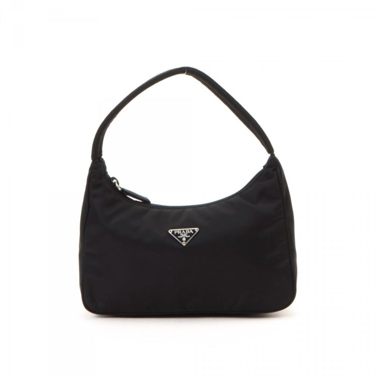 86aa5e54563a58 LXRandCo guarantees this is an authentic vintage Prada Tessuto handbag.  Crafted in nylon, this stylish handbag comes in black. Due to the vintage  nature of ...