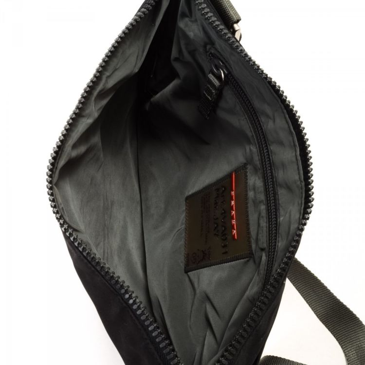 1c2c9d1a6859 LXRandCo guarantees the authenticity of this vintage Prada Sport Crossbody  Bag messenger   crossbody bag. This stylish pocketbook comes in black  polyester.