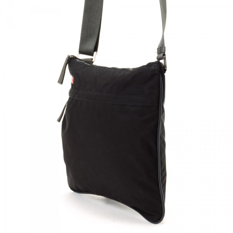 1bb69051fc45 LXRandCo guarantees the authenticity of this vintage Prada Sport Crossbody  Bag messenger   crossbody bag. This stylish pocketbook comes in black  polyester.