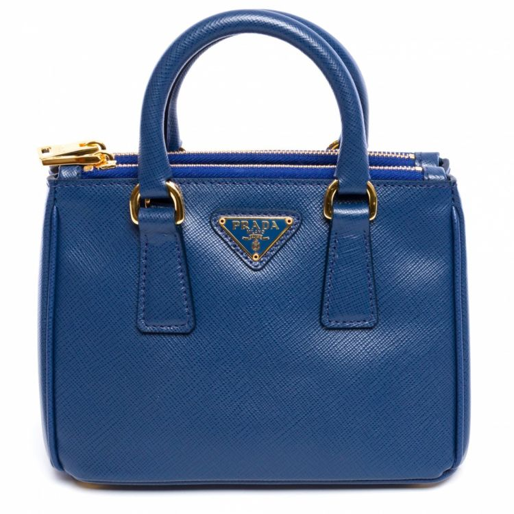 0a9757601e3 ... this vintage Prada Mini Galleria 1BH907 Bluette messenger & crossbody  bag. This luxurious saddle bag was crafted in saffiano leather in beautiful  blue.