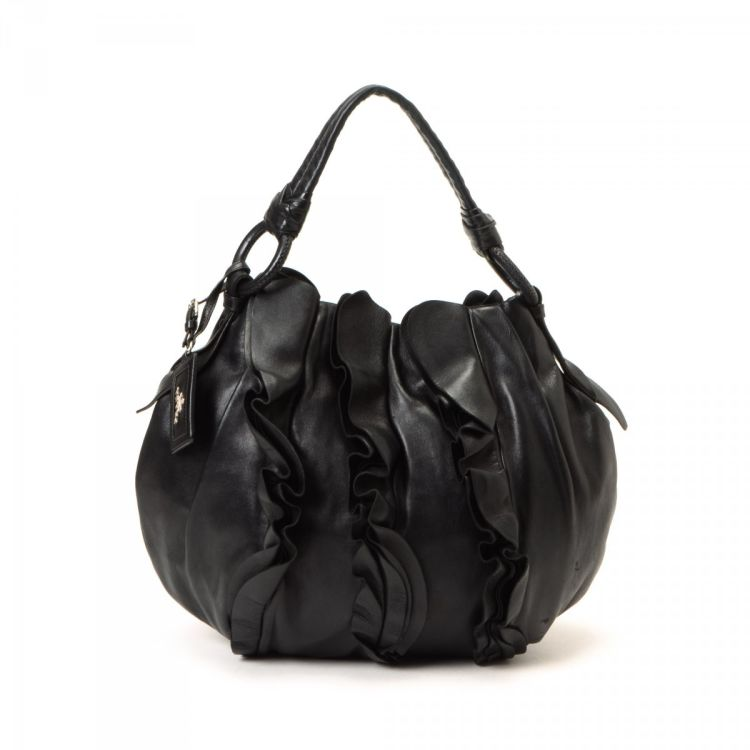 47b39c311020 LXRandCo guarantees the authenticity of this vintage Prada Ruffle Bag  shoulder bag. This lovely purse was crafted in napa leather lambskin in  black.
