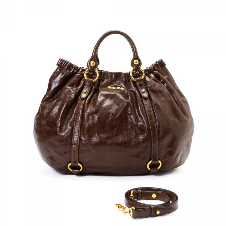 088449c61b04 LXRandCo guarantees this is an authentic vintage Miu Miu Two Way Bag handbag.  This stylish bag was crafted in vitello lux calf in brown.