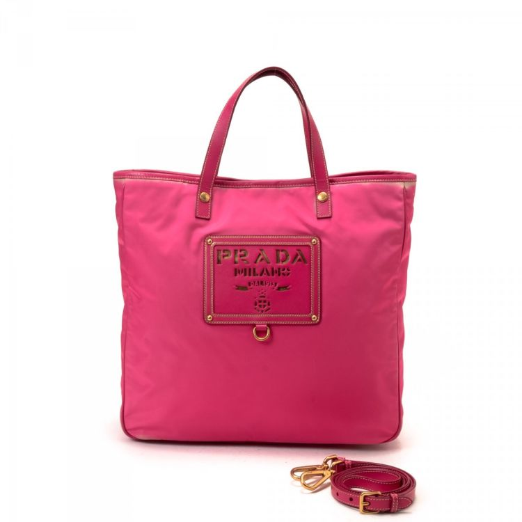5efe0646a980 The authenticity of this vintage Prada Tessuto Two Way Bag tote is  guaranteed by LXRandCo. This iconic large handbag comes in pink nylon.