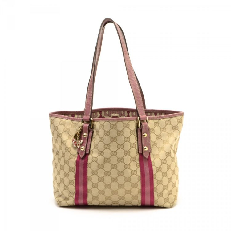 333b73b98b78c7 LXRandCo guarantees the authenticity of this vintage Gucci Jolicoeur  Butterfly tote. This luxurious bag in beige is made in gg canvas.