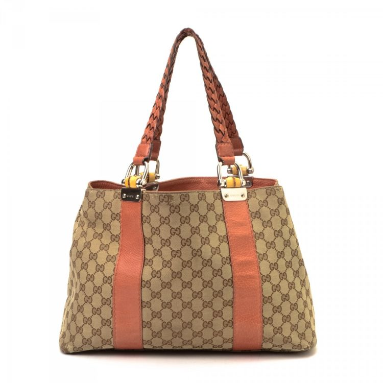 e0ca4439e8b LXRandCo guarantees this is an authentic vintage Gucci Bamboo Bar tote.  This beautiful work bag in beige is made in gg canvas. Due to the vintage  nature of ...