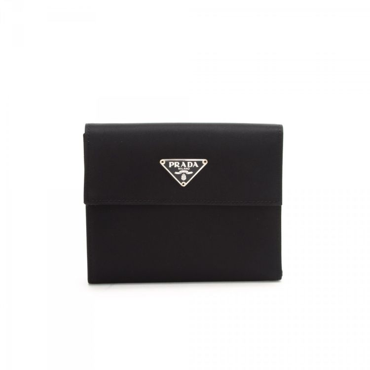 31db56a65f86 The authenticity of this vintage Prada Tessuto Tri Fold wallet is  guaranteed by LXRandCo. Crafted in nylon, this chic card holder comes in  beautiful black.