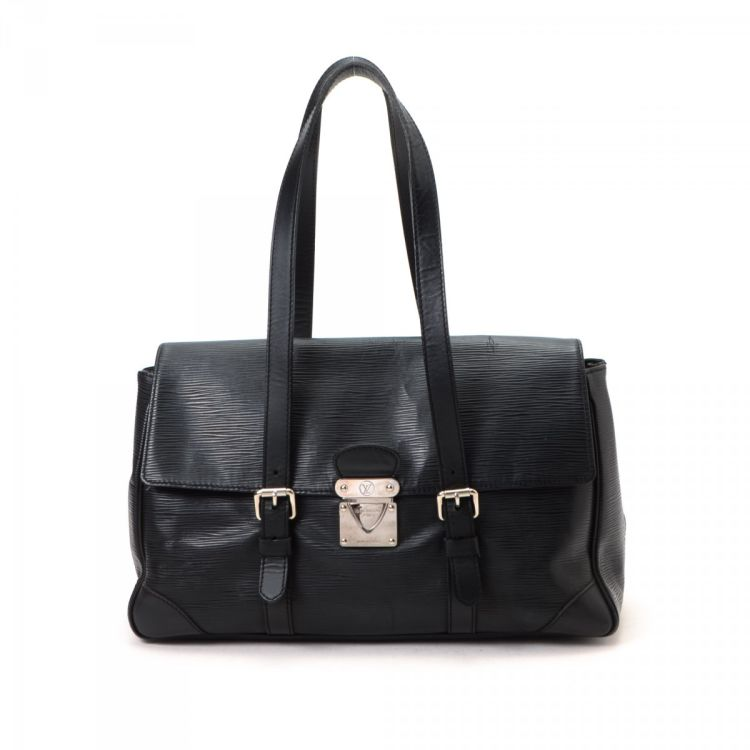 2730b8f945 LXRandCo guarantees the authenticity of this vintage Louis Vuitton Segur MM  shoulder bag. Crafted in epi leather, this practical pocketbook comes in  black.