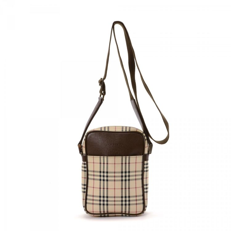 423ef1ea0e71 ... guarantees the authenticity of this vintage Burberry Crossbody Bag  messenger   crossbody bag. This classic saddle bag comes in beautiful beige  canvas.