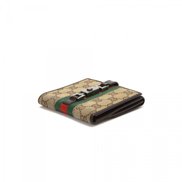 d150a10b7a47a2 LXRandCo guarantees the authenticity of this vintage Gucci Jackie Compact  wallet. This elegant card case was crafted in gg canvas in beige.