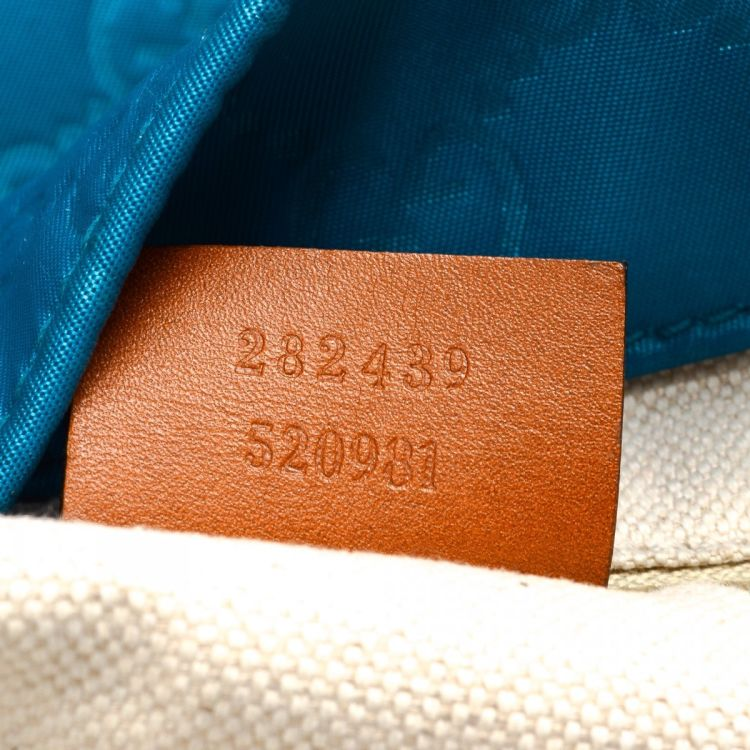 bb176c1acd4 LXRandCo guarantees the authenticity of this vintage Gucci Guccissima tote.  This elegant bag in blue is made in nylon guccissima nylon.