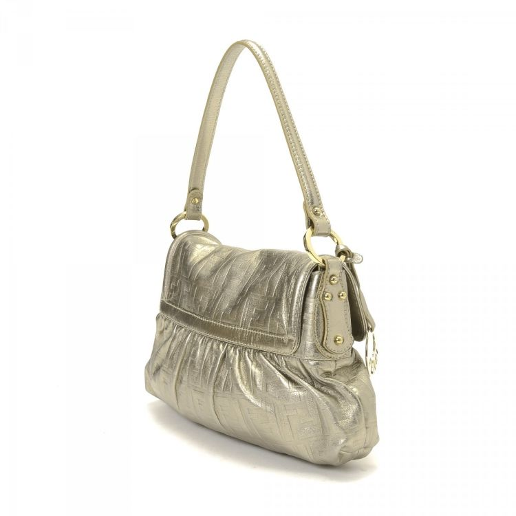 5aeb81aba17 LXRandCo guarantees the authenticity of this vintage Fendi Chef Bag handbag.  Crafted in zucca leather, this exquisite pocketbook comes in gold tone.