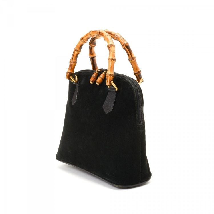 9b41d742809b LXRandCo guarantees the authenticity of this vintage Gucci Bamboo handbag.  This signature purse comes in beautiful black suede. Due to the vintage  nature of ...