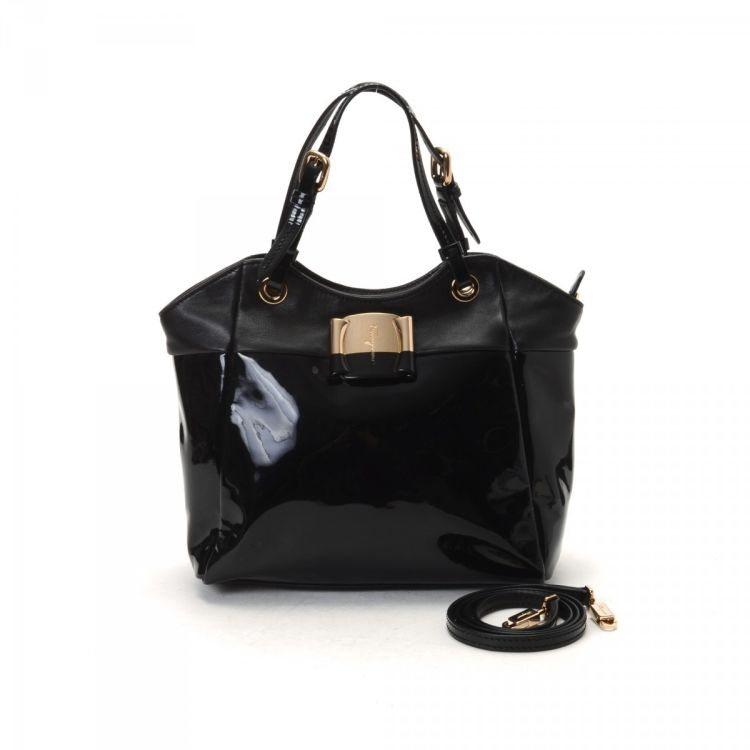 156c8c3e2b LXRandCo guarantees the authenticity of this vintage Ferragamo Vara Two Way Bag  tote. This luxurious tote comes in classic patent leather.