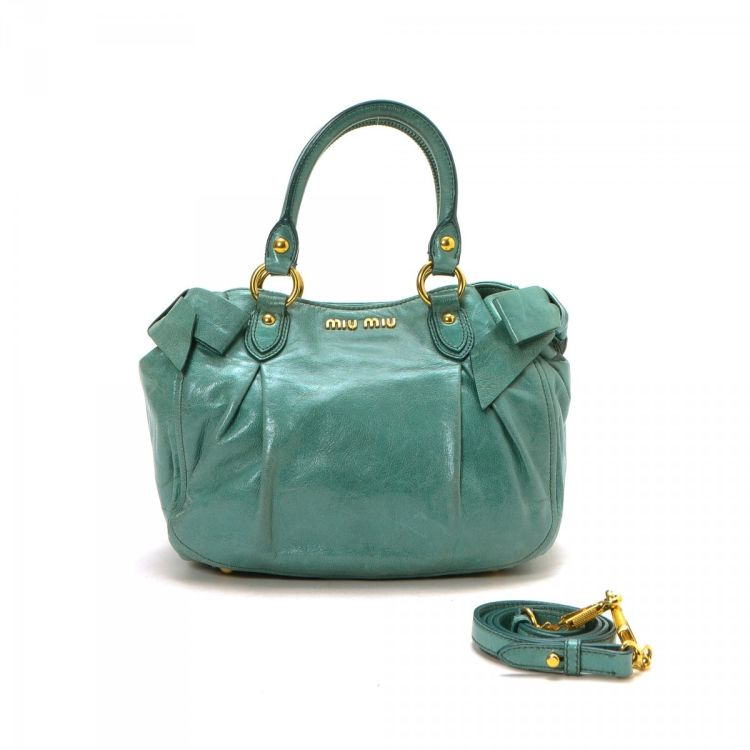 8a18f7aa66dac The authenticity of this vintage Miu Miu Vitello Shine Two Way Bow Bag  handbag is guaranteed by LXRandCo. This stylish purse in blue is made in vitello  lux ...