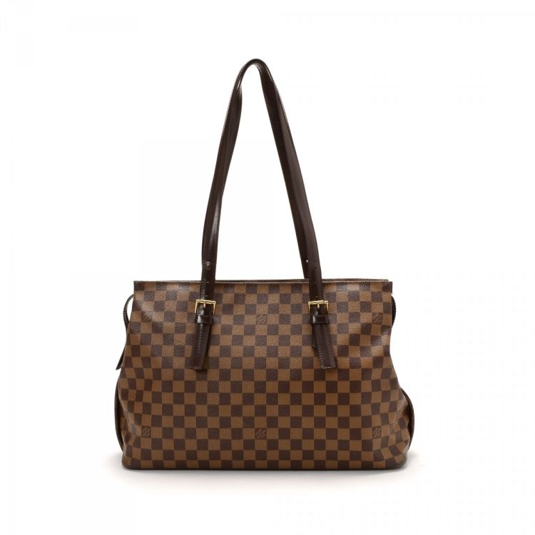 f6ddae96f7fd LXRandCo guarantees the authenticity of this vintage Louis Vuitton Chelsea  tote. This iconic work bag in brown is made in damier ebene coated canvas.