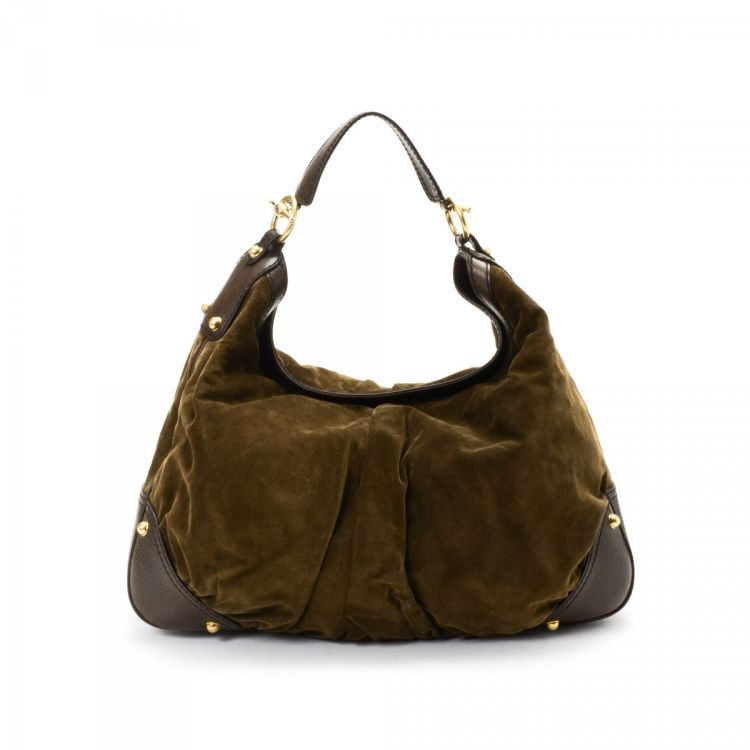 46e2072fb40 The authenticity of this vintage Gucci Jockey Hobo Bag shoulder bag is  guaranteed by LXRandCo. This iconic shoulder bag was crafted in suede in  dark brown.