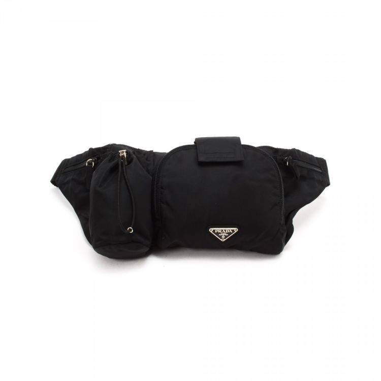d44c570f6ac0 LXRandCo guarantees the authenticity of this vintage Prada Tessuto Waist  Pouch vanity case & pouch. This lovely toiletry bag was crafted in nylon in  black.
