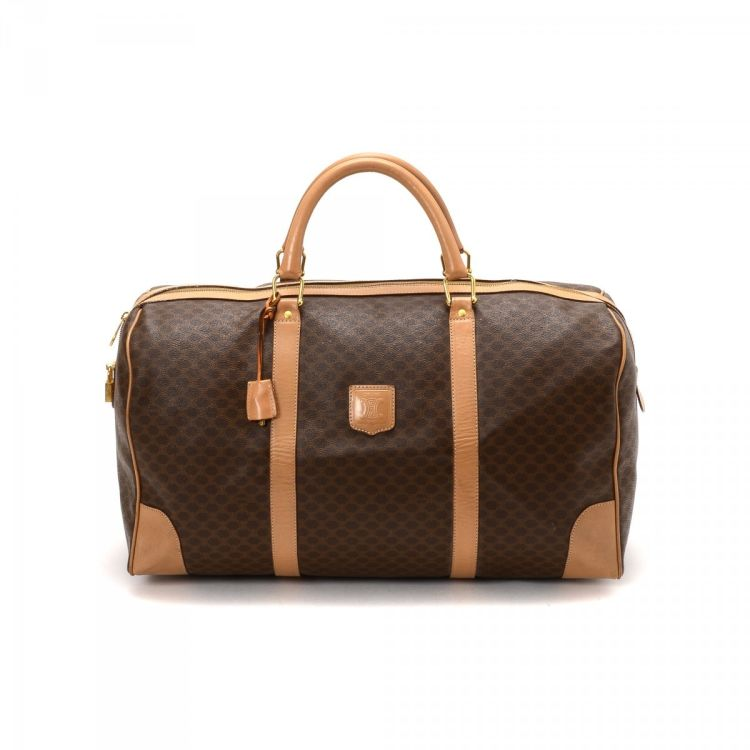 53799b1c0d LXRandCo guarantees the authenticity of this vintage Céline travel bag.  This stylish weekend bag in beautiful brown is made in macadam coated  canvas.