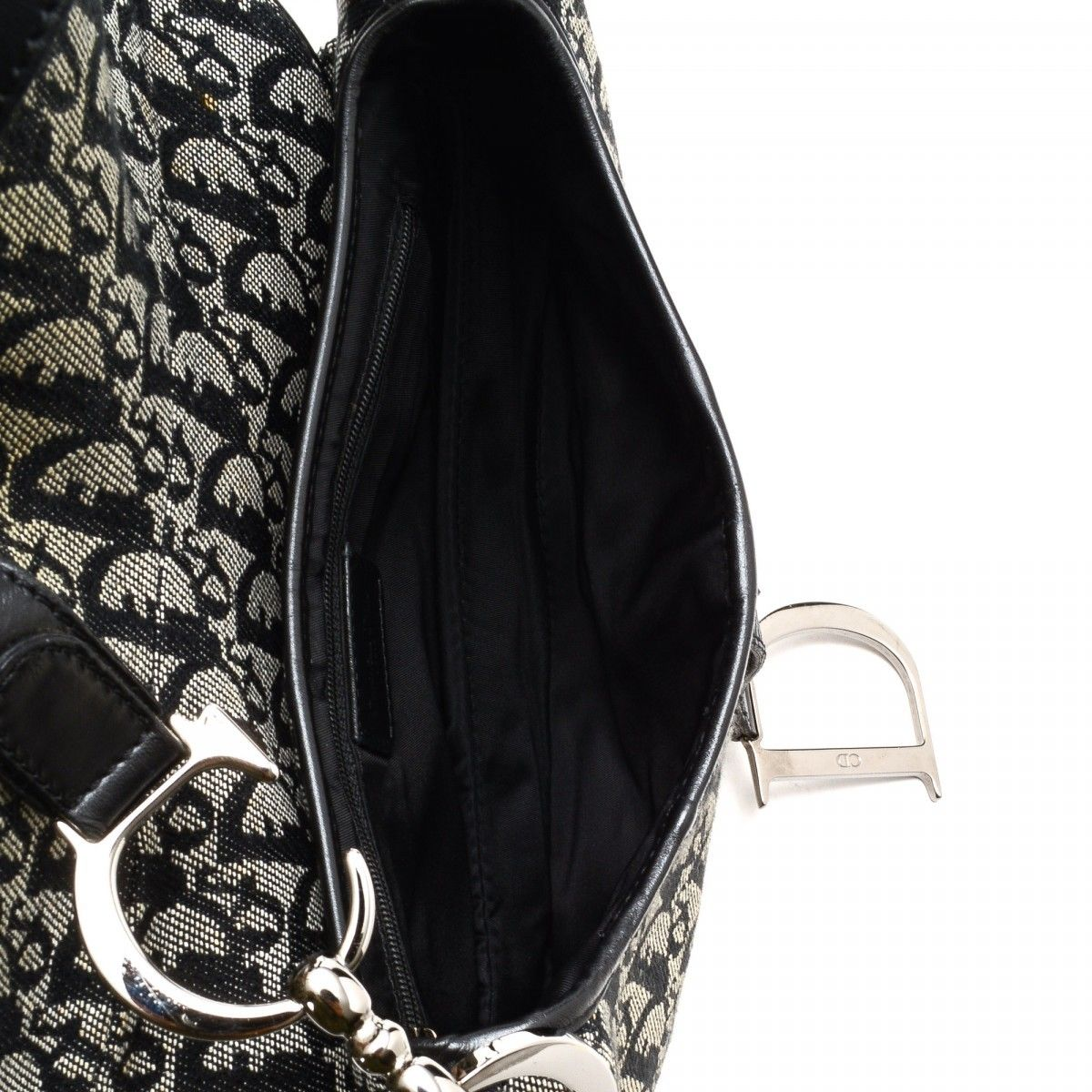 Dior Saddle Bag. LXRandCo guarantees the authenticity of this vintage Dior  Saddle Bag shoulder bag. This chic bag in beautiful black is made ... 6e9ecad9c4