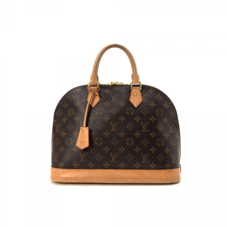 1341d8f9331b LXRandCo guarantees the authenticity of this vintage Louis Vuitton Alma MM  handbag. This everyday pocketbook was crafted in monogram coated canvas in  brown.