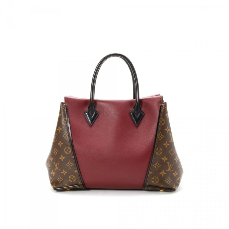 dfd32bbe2303 LXRandCo guarantees this is an authentic vintage Louis Vuitton W PM tote.  This iconic work bag was crafted in cuir orfevre coated canvas in prunille.