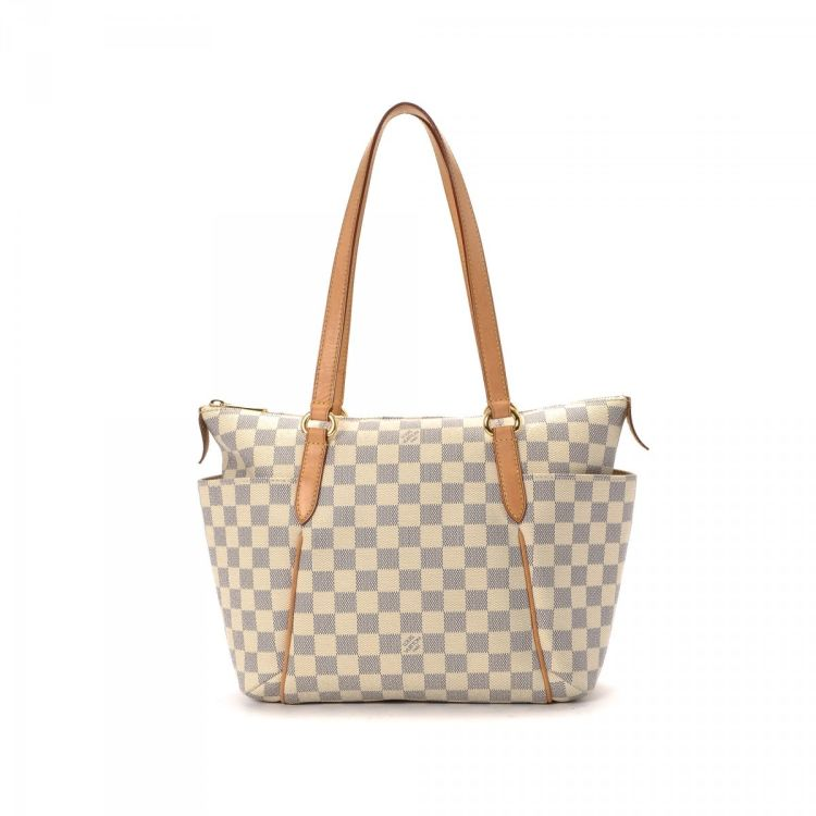 65a793b3b8a8 LXRandCo guarantees the authenticity of this vintage Louis Vuitton Totally  PM tote. This lovely bag comes in elegant coated canvas. Good condition   (AB)