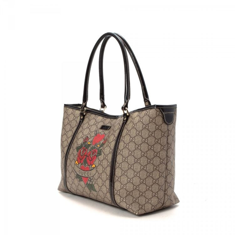 96ff74548ce LXRandCo guarantees this is an authentic vintage Gucci Rose Heart Tattoo  Bag tote. This refined tote bag comes in elegant coated canvas. Fair  condition  (B)