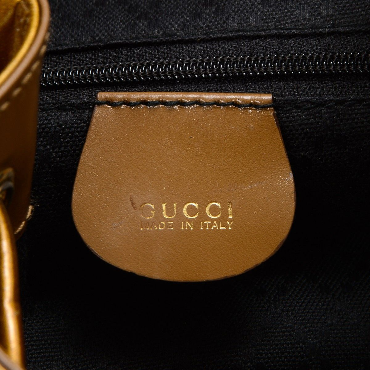 86e1ed420657 Bamboo Backpack. LXRandCo guarantees the authenticity of this vintage Gucci  Bamboo backpack. This chic school bag comes in patent leather. Good  condition  ...