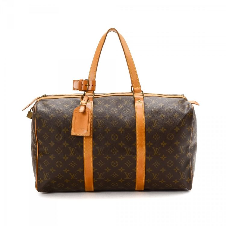 d94658f53800 ... of this vintage Louis Vuitton Sac Souple 45 travel bag is guaranteed by  LXRandCo. This luxurious weekender in brown is made in monogram coated  canvas.