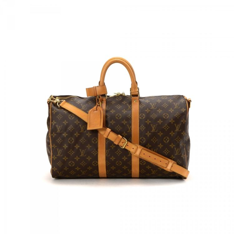 f18c1c23baca LXRandCo guarantees this is an authentic vintage Louis Vuitton Keepall 45  Bandouliere travel bag. Crafted in monogram coated canvas