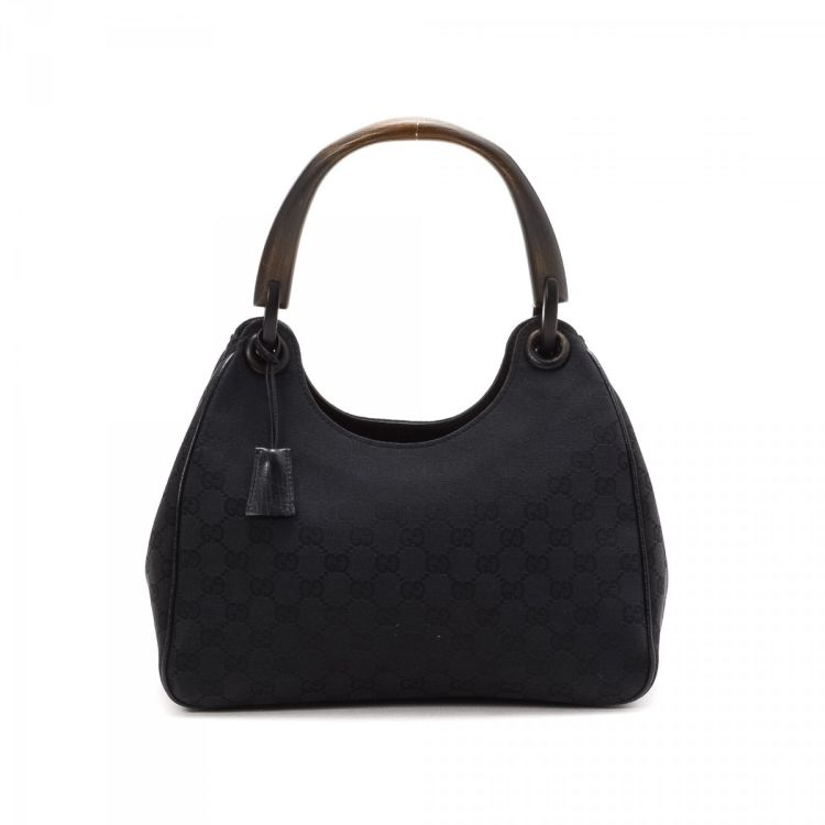 1ae4abf337fd8d LXRandCo guarantees the authenticity of this vintage Gucci Hobo Bag  shoulder bag. This sophisticated purse in black is made in gg canvas.