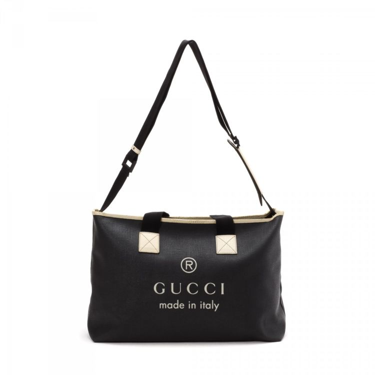 2793884fc6f The authenticity of this vintage Gucci Two Way Bag tote is guaranteed by  LXRandCo. This luxurious large handbag comes in black coated canvas.
