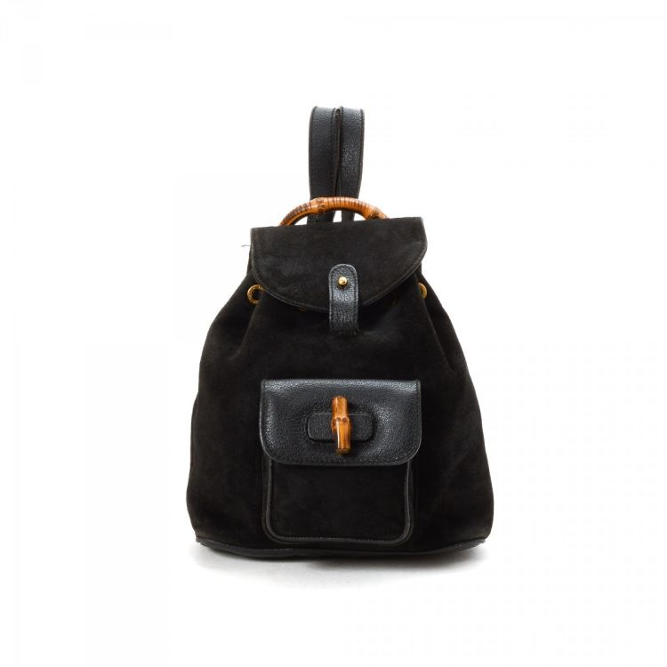 2da3ce14c6f81f LXRandCo guarantees the authenticity of this vintage Gucci Bamboo backpack.  Crafted in suede, this elegant school bag comes in black.