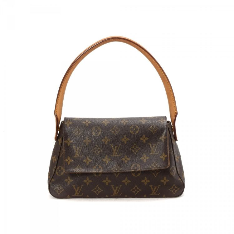 cfc296689 LXRandCo guarantees this is an authentic vintage Louis Vuitton Mini Looping  handbag. This chic bag was crafted in monogram coated canvas in brown.