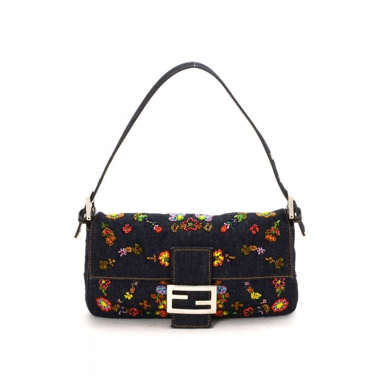 d969002f91b6 The authenticity of this vintage Fendi Beaded Embroidered Baguette shoulder  bag is guaranteed by LXRandCo. This lovely purse comes in navy canvas.