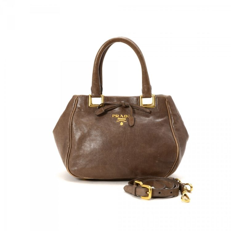 f4e1b2de8e43 LXRandCo guarantees the authenticity of this vintage Prada Two Way Bag  handbag. This luxurious purse comes in leather. Fair condition* (B)