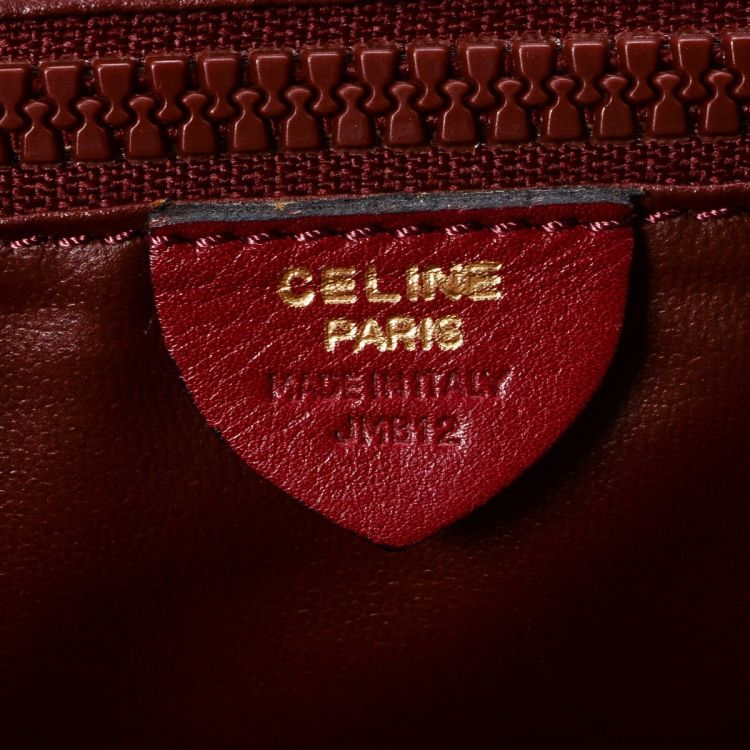 4df4a133ae41d LXRandCo guarantees this is an authentic vintage Céline shoulder bag. This practical  bag comes in red leather. Due to the vintage nature of this product