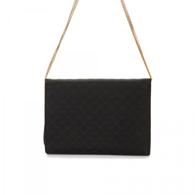 9c26357a7d67 The authenticity of this vintage Gucci Evening Bag shoulder bag is  guaranteed by LXRandCo. Crafted in satin, this exquisite pocketbook comes  in black.